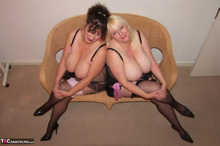 Essex housewife Kim and her busty mate have fun at a swingers den